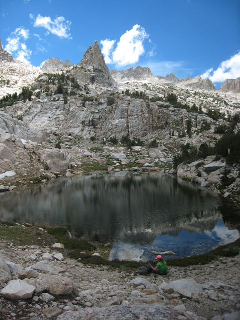 Resting at the small lake you encounter before the last, grueling mile up some talus during the approach to Matterhorn. The spire in the background is Horsetail spire. Photo by Benjamin Poirier.