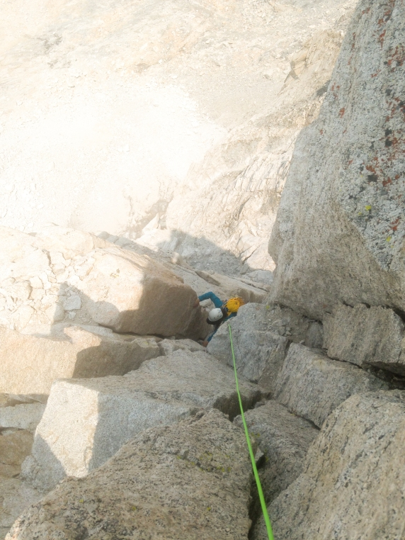 My partner following me up on the crux chimney pitch. It was a pretty mellow pitch and loads of fun.