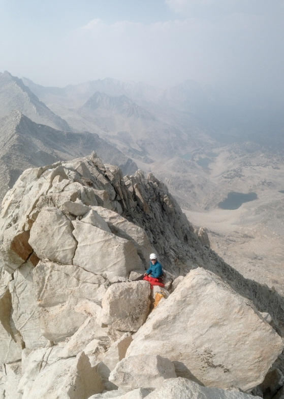 My partner right below the summit block. Notice the haze in the sky from the Rough Fire down south in Sequoia & Kings Canyon National Park